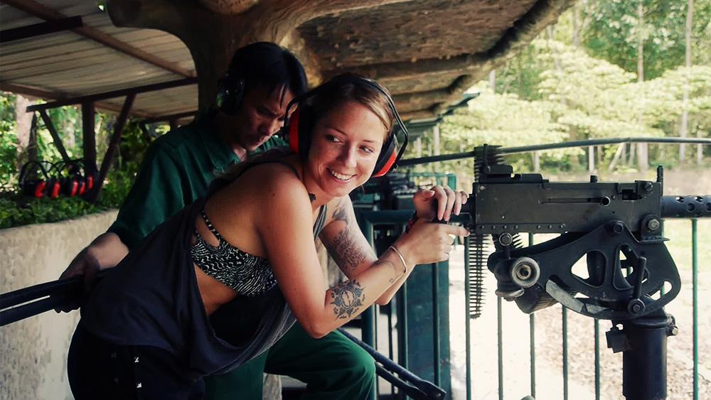 ALL OF US impact tourism Vietnam Cuchi tunnels shooting gun